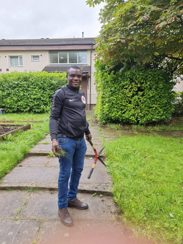 Joseph helping in the Eccy garden